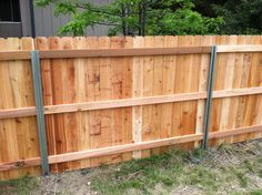 Steel Posts (?Postmaster) with Cedar Privacy Fence - Back Side