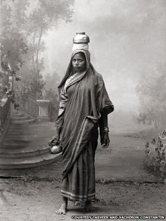 A woman carrying a pot, 1870