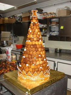 pièce montée de choux.  This is NOT a Christmas tree.  It's the typical French dessert at weddings (in place of a wedding cake).