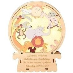 Like a crystal ball giving them a window onto the world, this cute wooden plaque brings them a view of animals such as a lion, monkey, even fish! As the sun shines the creatures frolic above a poem fo . Gift Of Faith, Catholic Company, Sun And Stars, Wooden Plaques, Religious Gifts, Snow Globes, Create Yourself, Everything, Singing
