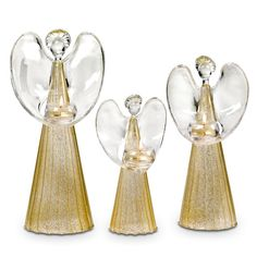 """Radiant sculpted glass angels spread hope, love and peace! Add a tealight, sold separately, to the attached glass cup and set the gold-flecked gowns aglow. Set includes one of each height: 8½""""h; 10¾""""h; 12½""""h."""