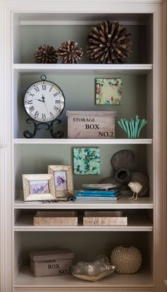I like how this built-in is accessorized and those porcupine-like twig balls caught my eye as a quick and easy DIY project!