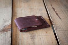 Mens Handstiched Minimal Red Leather Wallet with Ball closure by SocialTheoryLeather on Etsy https://www.etsy.com/listing/248706972/mens-handstiched-minimal-red-leather