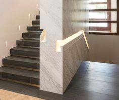 Stair Design Ideas - 9 Examples Of Built-In Handrails // In this home, the stair handrail was first built into the wall, which was then clad in marble.