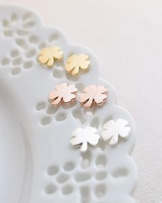 These little lucky shamrock earrings are perfect for everyday wear. Available in silver, gold or rose gold. By Olive Yew.