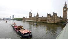 Sweet sound: The Royal Jubilee Bells, on Ursula Catherine Belfry Barge, passed the Palace of Westminster at the head of the Diamond Jubilee Thames River Pageant