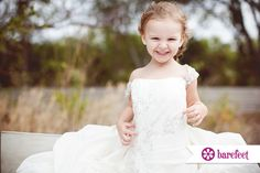 Sweet little girl playing dress-up in her mother's wedding dress