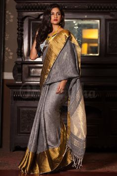 Rich and flowy grey linen saree from Roopkatha is all set to scintillate with magnificent wide zari border. The linen saree is perfect for those who wish to rem Indian Attire, Indian Ethnic Wear, Handloom Saree, Silk Sarees, Cotton Saree, Sabyasachi Sarees, Indian Sarees, Ethnic Fashion, Indian Fashion