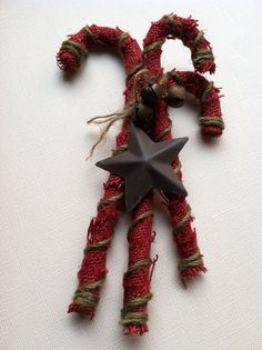Rustic Burlap Candy Canes. Split them up or keep them together they are rustic cute. The plastic canes are wrapped in a warm red with gold. Vintage Christmas DIY Decor ideas for Woodland theme