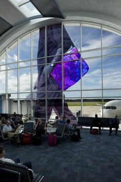 Gotta Go, Jacksonville International Airport, 2008 | 2 murals @ 35' H x 35' W. Digital Print & Dichroic glass | Jacksonville, FL
