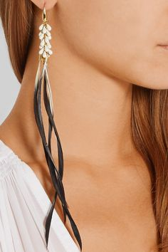 ISABEL MARANT Gold-tone, resin and feather earrings €190.00 http://www.net-a-porter.com/products/545549
