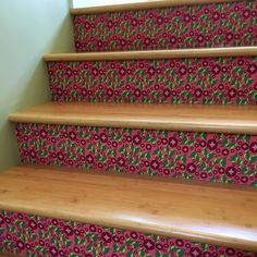 Gift Wrap Wednesday: Accent your stairs! I keep expecting not to be surprised when I walk up the stairs and see this fun and welcoming punch of color. I have 12 stairs and it took three rolls of gift wrap so this whole project cost $45. So many smiles for under fifty bucks. #fabric  #fabrics #sew #sewing #misschiffdesigns  #crafty #quilt #quilting #homedecor #interior #pattern #fabric #fabrics #diy #diyfashion #wrappingpaper #illustrator #decoration #fabricdesigner #mailartist #homedecor…