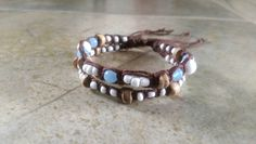 Check out this item in my Etsy shop https://www.etsy.com/listing/229535590/brown-bamboo-bracelet-blue-gemstones