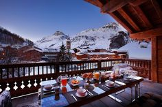 Stunning snow-covered peaks and quiet landscape viewed from the balcony of the luxury chalet