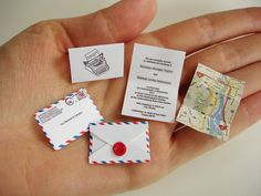 Teeny Tiny Wedding Invitation with map by World's Smallest Post Service. It comes with an itty bitty magnifying glass. So cute!