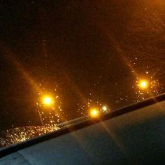 Lights. Rain. Car.