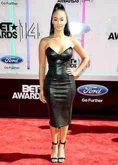 Draya Michele rocked a strapless Michael Costello dress with Giuseppe Zanotti heels at the 2014 BET Awards.