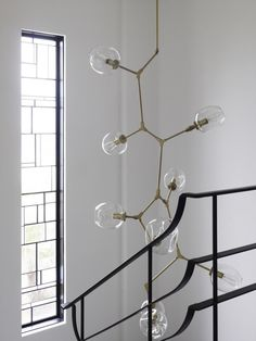 Amazing chandelier for a stairwell... Middle Park House / KPDO + CJA
