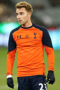Christian Eriksen Photos Photos - Christian Eriksen of Tottenham warms up prior to the 2016 International Champions Cup Australia match between Tottenham Hotspur and Atletico de Madrid at Melbourne Cricket Ground on July 29, 2016 in Melbourne, Australia. - Tottenham Hotspur v Atletico De Madrid - 2016 International Champions Cup Australia