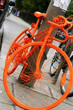 Someone please explain this to me. I see these beautiful orange painted bikes all over town.