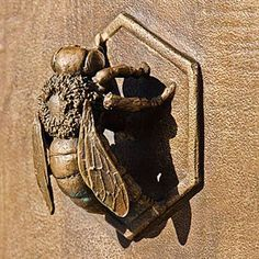 Bee door knocker on gate - Avenue Station, Sunset Park, Brooklyn
