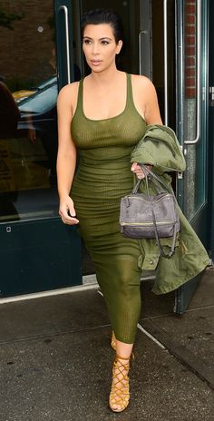 Kardashian hit the streets of New York City in a sheer green ribbed dress and lace-up heels.