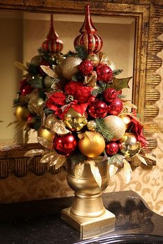 MUST DO Christmas arrangement idea- use my mercury glass topper w/urn and silver spray paint n vintage ornaments