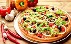 Pizza , Italian pronunciation: [ˈpittsa]) is an oven-baked, flat, round bread typically topped with a tomato sauce... #pizza #food #delivery #chinese #takeaways