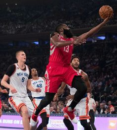 Houston Rockets guard James Harden (13) goes to the basket during the first half