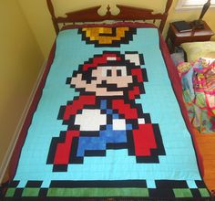 Quilting: 8-Bit Mario Quilt.  I might actually try this as my next quilting project. :)