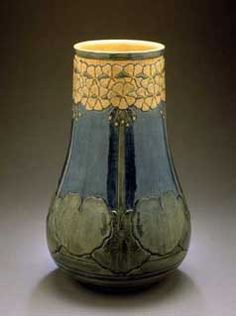 Newcomb College Pottery.  Decorated by Mazie Teresa Ryan thrown by Joseph Fortune Meyer   1906  Earthenware  Height:  12-7/8 in.