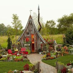 This garden shed is unlike anything we've ever seen! Dan Pauly designed this unusual shed, with its distinctively crooked chimney and… shed design shed diy shed ideas shed organization shed plans Fairy Houses, Play Houses, Garden Cottage, Home And Garden, She Sheds, Shed Plans, Little Houses, Future House, Outdoor Gardens