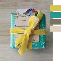 Gift box in bright colors adorned with a velvet ribbon and a gift card envelope... darling.