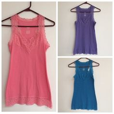 3 Lace Mossimo Tank Tops These have been very lightly worn, they're all in excellent condition. They look brand new. Selling them all together or separately. Offers welcomed  Don't forget you can bundle these three shirts with other items in my closet for 10% off! Mossimo Supply Co Tops Tank Tops