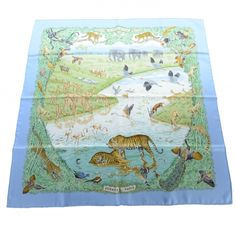 This is an authentic HERMES Silk La Treve de L eau Scarf 90.   This lovely scarf is 100 silk and features a stunning pattern of plains and animals.