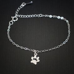 Pawmeasures approximate 8.5mm x 8.5mm. Braceletis adjustable from 6″-8.5″, with a durable springclasp. Pair it with our Petite Heart with Paw Cut Out Bracelet!  Zinc alloy with durable rhodium plating, or gold plating.