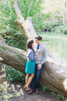 Pin for Later: Sunny Spring Inspiration For Your Engagement Shoot Pose by a Tree Source: Trent Bailey Photography via Style Me Pretty