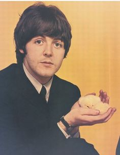 Paul McCartney with a chick ;)