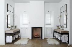 Fireplace in this master bathroom - An Elegant Napa Valley Home   La Dolce Vita