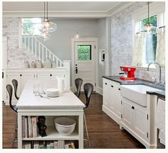 i want to open up the wall to bring the staircase into the kitchen area in our home
