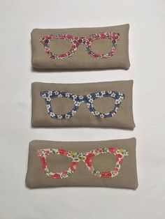 An eye-catching way to protect your specs! Made to order, but I do have a few ready made glasses cases ready to post - please contact me to discuss what is available. This glasses case is made from either linen style fabric or upcycled denim, lined with soft protective velvet and