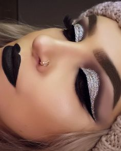 If you can't decide to go for a dark or light look for the day, why not go for both with this Smokey glittery look!