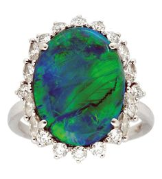 A Black Opal and Diamond Ring, Birks  Set with an oval black opal measuring 16.7 mm by 12.5 mm by 4.7 mm, surrounded by a decorative frame of round and marquise-cut diamonds, mounted in platinum, signed Birks