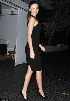 Timeless: The 29-year-old model oozed old Hollywood glamour in her stylish LBD, which she teamed with a pair of fierce stilettos and a slick of scarlet lipstick