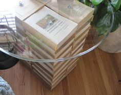 i do need a table:  i have the glass top & the books ~ recover books in pretty fabric or cloth