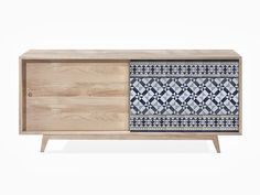 WeWood. The Manuel sideboard, also available in oak and walnut, features hand-painted Portuguese ceramic for the door lining