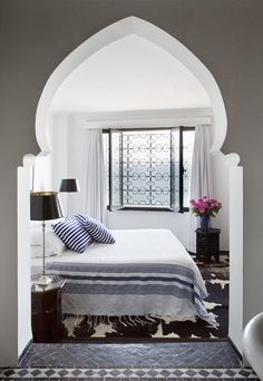 Gorgeous Moroccan archway leading to the bedroom--image via Lotus and Fig