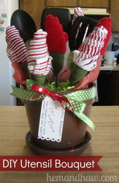 """DIY """"Gift Basket of Potted ♥ Appropriates!"""" by Hem and Haw: DIY Utensil Bouquet! For a baby shower, you can use baby washcloths and onesies to make the flowers, & things like bottle scrubbers could also make up the bouquet. ~ While kitchen timers & measuring cups/spoons tied to the side would look adorable for the new bride or as a house warming gift.  Oh so versatile gift pots. ;-)"""