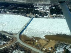 """An ice jam starting at the St. John River bridge in Allagash stretches nearly four miles up the river to the head of the &quotbig rapids"""" on Thursday. Northern Maine, The St, Airplane View, Thursday, Stretches, Bridge, Rain, Ice, Outdoor Decor"""