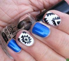 Royal blue and black and white aztec nails